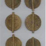 Gelbguss-Amulette